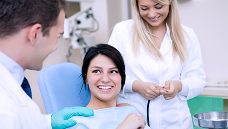 Happy patient with Group Dental Insurance at dentist's office