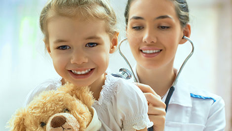doctor and young patient covered by a critical illness insurance policy